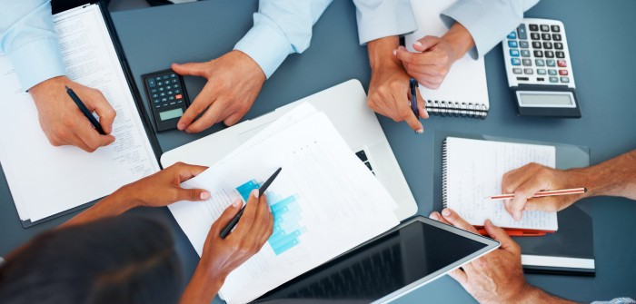 Cropped image of hands of businesspeople working together on business project at office - Consulting
